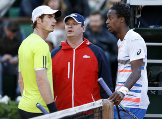 Andy Murray of Britain and Gael Monfils of France argue with a referee during their men's quarter-final match at the French Open Tennis tournament at the Roland Garros stadium in Paris