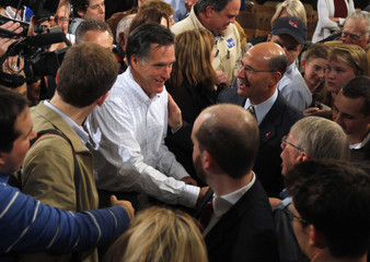Republican presidential candidate and former Massachusetts Governor Mitt Romney shakes hands with supporters after delivering a speech about his fiscal policy in Exeter