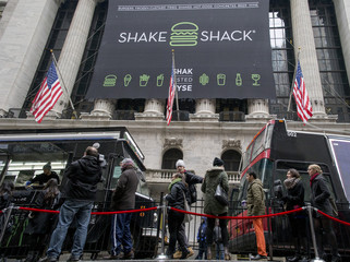 Patrons stand in line for free breakfast from Shake Shack in front of New York Stock Exchange to celebrate the company's IPO