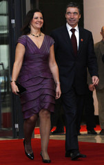 NATO Secretary-General Rasmussen and his wife Anne-Mette arrive at the Istanbul Congress Center in Istanbul