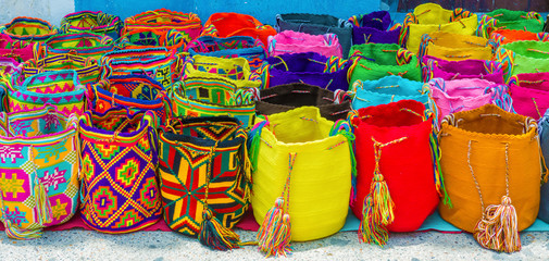 Street vendor selling craft bags in Cartagena, Colombia