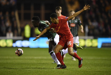 Plymouth Argyle's Jordan Slew in action with Liverpool's Trent Alexander-Arnold