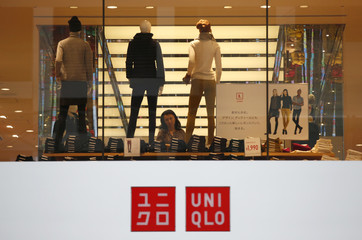 A woman checks clothes at Fast Retailing's Uniqlo casual clothing store in Tokyo