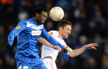 KRC Genk's Kumordzi fights for the ball with VfB Stuttgart's Gentner during their Europa League soccer match in Genk