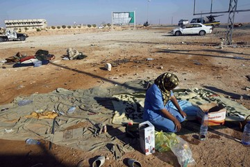 Medic sits at a checkpoint manned by anti-Gaddafi forces, north of the besieged city of Bani Walid