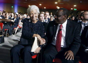 IMF Managing Director Lagarde shakes hands with Rwanda's Minister for Finance and Economic Planning Gatete at the 2015 IMF/World Bank Annual Meetings in Lima