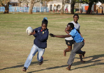 Members of the Jabulani rugby club take part in a rugby practice in Soweto