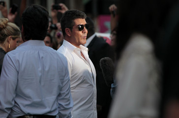 """Cowell is interviewed at the season two premiere of the television series """"The X Factor"""" at Grauman's Chinese theatre in Hollywood"""