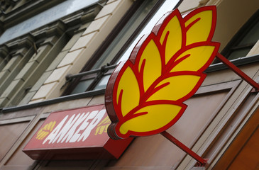 The logo of Austrian bakery chain Anker is pictured above a shop in Vienna