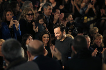 French designer Nicolas Ghesquiere appears at the end of his Fall/Winter 2014-2015 women's ready-to-wear collection show for fashion house Louis Vuitton during Paris Fashion Week