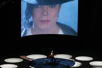 Singer Taylor performs as a picture of Jackson is displayed during a segment at 82nd Academy Awards in Hollywood