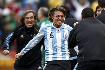 Argentina's Heinze celebrates scoring against Nigeria during a 2010 World Cup Group B soccer match at Ellis Park stadium in Johannesburg
