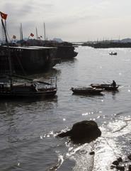 A man sails a boat on Halong Bay