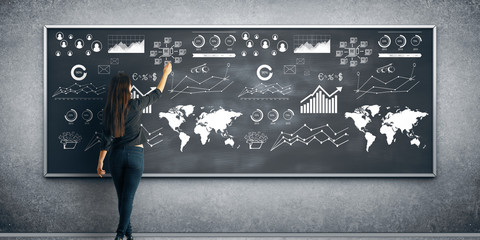 Woman drawing business charts