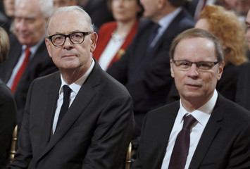 French economist Tirole, the 2014 Economics Nobel Prize laureate, and Modiano, French novelist and 2014 Nobel Prize laureate for literature, wait before being awarded with the Officier de la Legion d'Honneur at the Elysee Palace in Paris