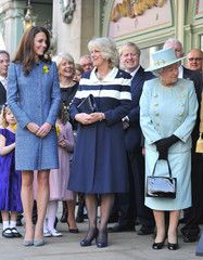 Britain's Queen Elizabeth, Camilla, Duchess of Cornwall and Catherine, Duchess of Cambridgeawait ahead of a plaque unveiling, as London Mayor Johnson looks on outside of the Fortnum and Mason store in central London