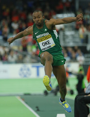 Oke of Nigeria participates in the triple jump final during the IAAF World Indoor Athletics Championships in Portland
