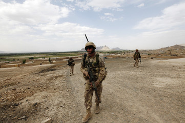 Canadian soldiers from Camp Nathan Smith walk to the village of Ghazi Kalai in Kandahar City