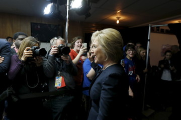 Clinton arrives for a campaign event at the Adel Family Fun Center bowling alley in Adel, Iowa