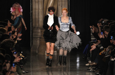 Designer Vivienne Westwood walks on the catwalk with her models following the presentation of her Fall/Winter 2011 collection at London Fashion Week