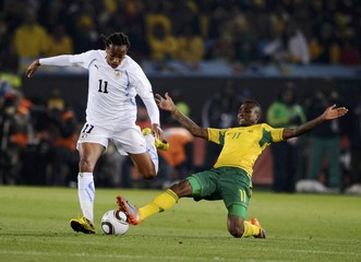 South Africa's Modise fights for the ball with Uruguay's Pereira during a 2010 World Cup Group A soccer match in Pretoria