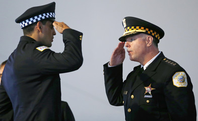 Chicago Police Superintendent Garry McCarthy returns a salute to an unnamed recruit during a recruitment graduation ceremony in Chicago