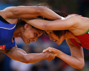 South Korea's Jieun Um fights with Tunisia's Marwa Amri on the Women's 55Kg Freestyle wrestling at the ExCel venue during the London 2012 Olympic Games