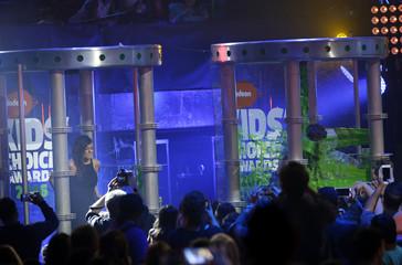 "Mota misses getting ""slimed"" as Dallas is sprayed at Nickelodeon's 2016 Kids' Choice Awards in Inglewood"