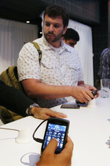 People test the new BlackBerry Torch 9800 smartphone after it was introduced at a news conference in New York