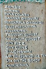 Wooden drink menu board in cocktail bar. Cocktail list in restaurant menu