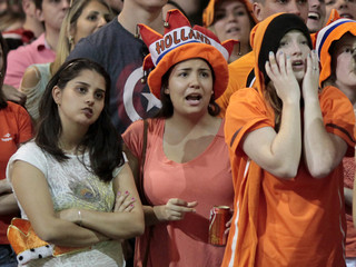 Fans reacts while watching a broadcast of the 2014 Brazil World Cup quarterfinal game between Costa Rica and the Netherlands in Holambra