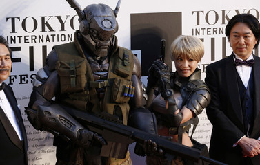 "Characters of Japanese animation ""APPLESEED ALPHA"" pose for photography during the opening event of the Tokyo International Film Festival in Tokyo"