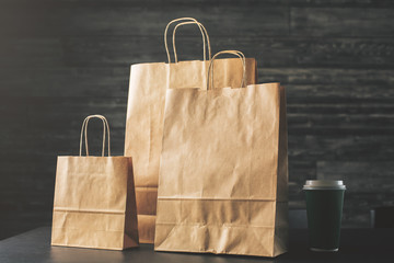 Brown shopping bags and coffee front