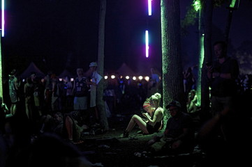 Women use their smartphones during the Firefly Music Festival in Dover