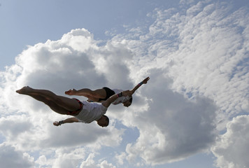 Competitors jump into the water during a cliff diving competition near the central Bohemian village of Hrimezdice