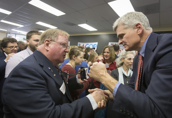 Republican senatorial candidate U.S. Rep. Bill Cassidy greets supporter Francis J. Richardson III during a rally in Lafayette