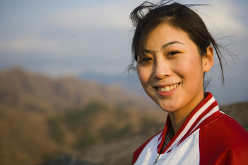 Portrait of young Chinese woman at the Great Wall Of China.