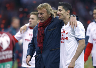 Poland's Lewandowski and Presidnet of the Polish Football Association Boniek celebrate after winning Euro 2016 qualification soccer match against Republic of Ireland in Warsaw
