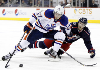 Edmonton Oilers' AntonLander scores a goal after being hit by Columbus Blue Jackets' Brassard during first period of their NHL hockey game in Columbus