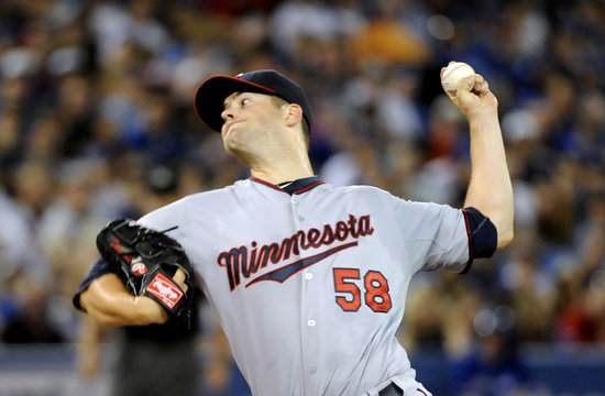 Twins' Diamond pitches against the Blue Jays in the first inning of their MLB American League baseball game in Toronto