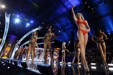 Miss America 2014 contestants, Miss Kansas Theresa Vail stands with Miss New York Nina Davuluri in their bathing suits while competing in the Miss America Pageant in Atlantic City, New Jersey