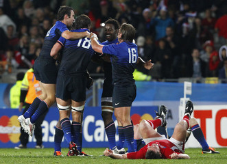 France's players celebrate after winning their Rugby World Cup semi-final match against Wales in Auckland