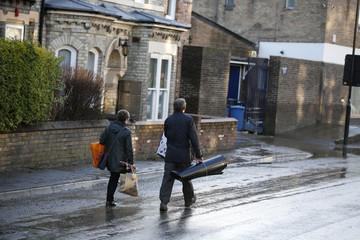 Residents carry their belongings on Huntington Road in York