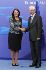 EU Council President Van Rompuy poses with Kosovo's President Atifete Jahjaga in Brussels