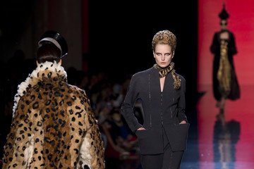 Models present creations by French designer Jean Paul Gaultier as part of his Haute Couture Fall Winter 2013/2014 fashion show in Paris