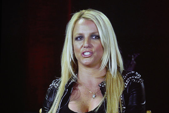 """Singer Britney Spears, a judge from the reality series """"The X Factor"""", is pictured on a video screen via satellite from Miami at the Fox  television network portion of the Television Critics Association Summer press tour in Beverly Hills"""