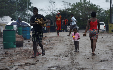 Migrants stranded in Costa Rica from Haiti and Africa walk at a makeshift camp, at the border between Costa Rica and Nicaragua, in La Cruz