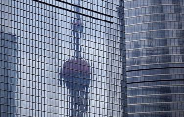 The Oriental Pearl TV Tower is seen reflected on an other building at Pudong financial district in Shanghai