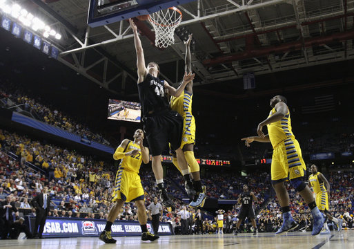 Marquette University's Wilson blocks shot of Butler University's Smith during their third round NCAA basketball game in Lexington