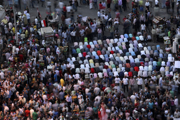 Protesters pray after a court sentenced deposed president Hosni Mubarak to life in prison at Tahrir Square in Cairo